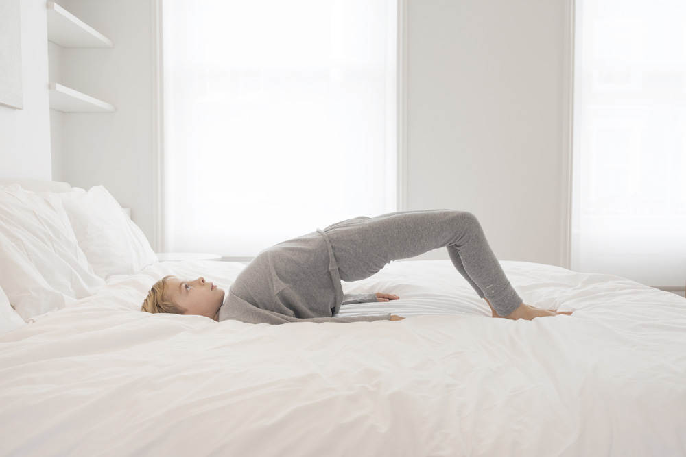 Lazy Yoga: 5 Relaxing Yoga Poses You Can in Your Own Bed