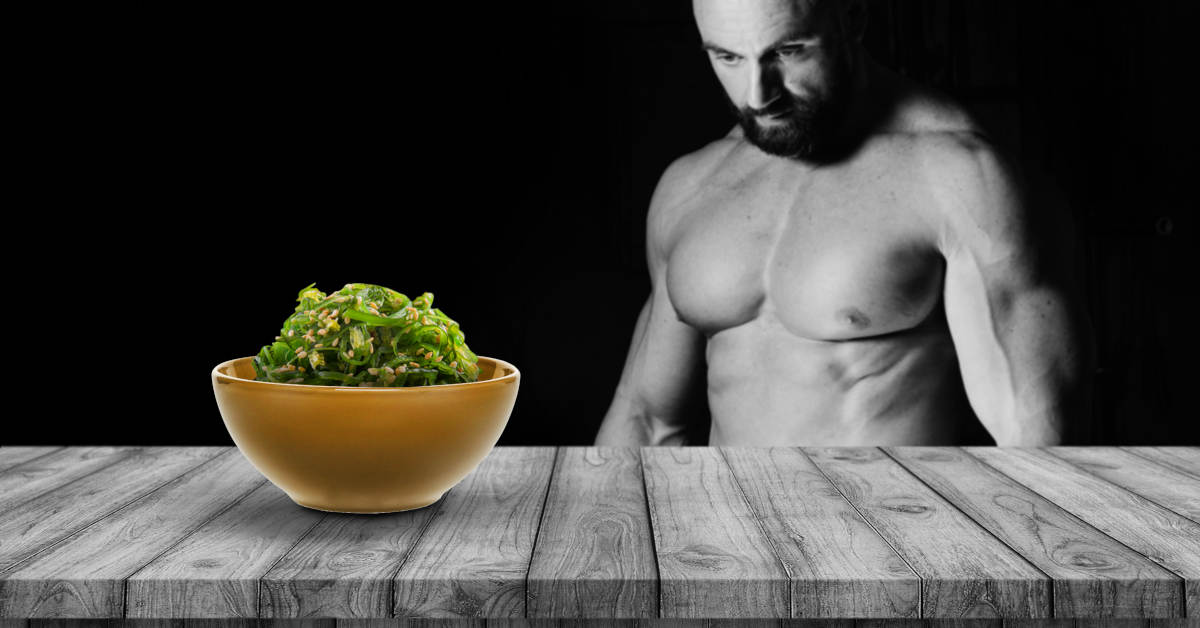 9-surprising-superfoods-featured-image-body-builder-looking-at-seaweed
